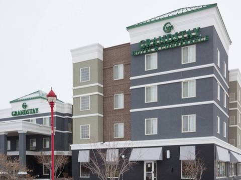 The GrandStay Apple Valley, MN hotel features a distinct tri-color design...