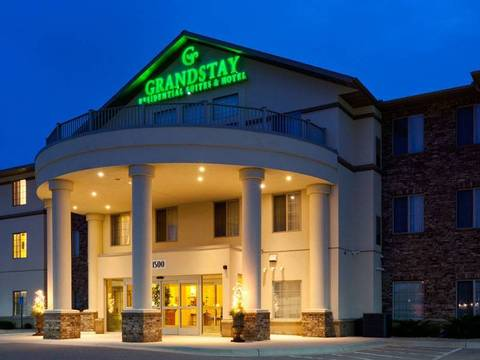 Stunning evening shot of the rounded four column entrance to the GrandStay...
