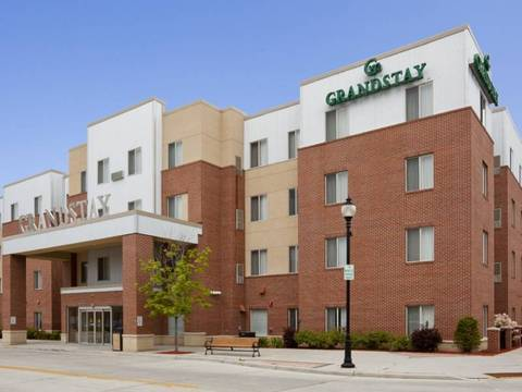 Entrance to the GrandStay Hotels in Sheboygan, WI is inviting with red brick,...