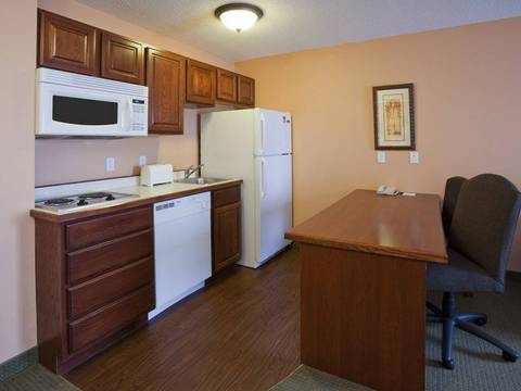 Extended stay hotel room in Apple Valley, MN features a fully equipped...